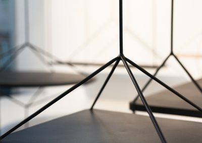 Interior photography showing suspended furniture detail