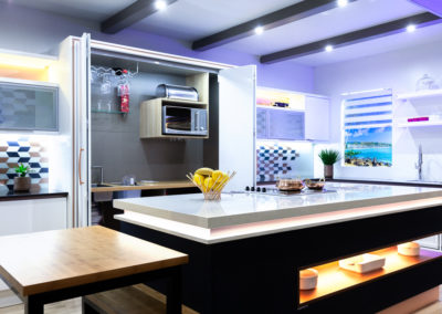 Photograph of a modern kitchen with cupboards open at Decorex 2018