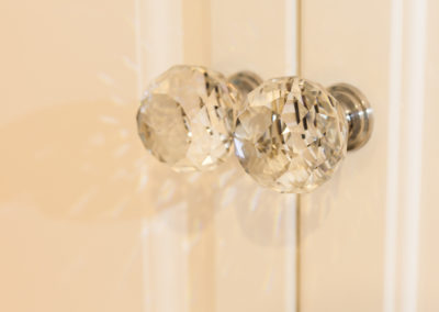 Close up photograph of some glass door handles