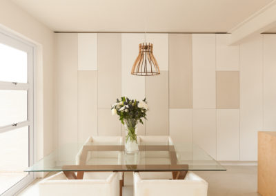 Interior photography showing modern minimalist dining room