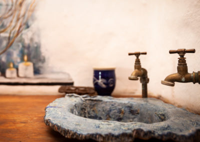 Interior photograph of the quaint basin in a country lodge in the Kzn Midlands